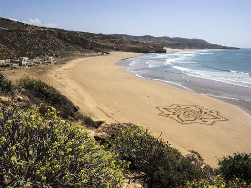 Iftane, beach art, sand drawing, dougados, morocco, essaouira